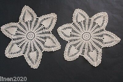 Two (2) vintage ecru crocheted star-shaped doilies.