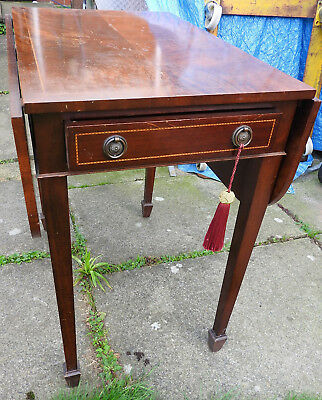 early 20th Century drop leaf table , raised on square tapered legs