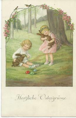 Pauli Ebner. Children play with  Easter rabbits