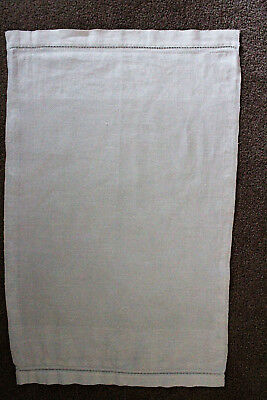 Vintage off-white hand towel/cloth with embossed design on edges.