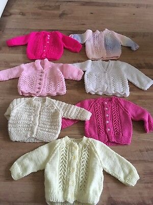 Selection of 7 hand knitted cardigans size 24cm chest