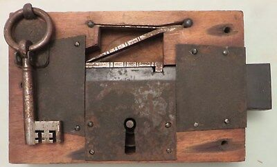 """An old antique 10"""" wooden cased rim stock lock with working ring bow key. Wood."""