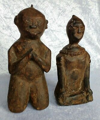 Two carved wooden Nepalese kneeling votive figures Himalayan tribal statues
