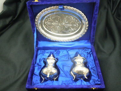Silver salt and pepper condiment pots with tray in a velvet display box