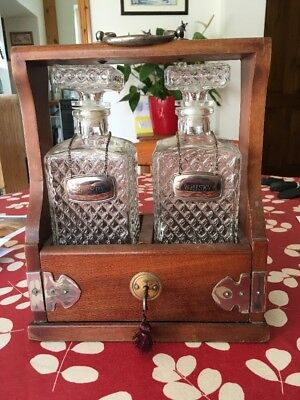 Tantalus Complete With Key Two Decanters And Silver Plate Labels