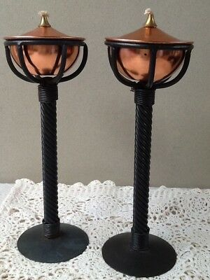 A lovely pair of matched Black twist metal and copper coloured font oil lamps