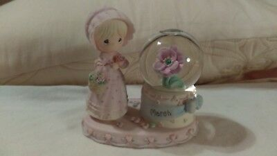 Precious Moments Birthstone March girl next to water globe with flower & birth