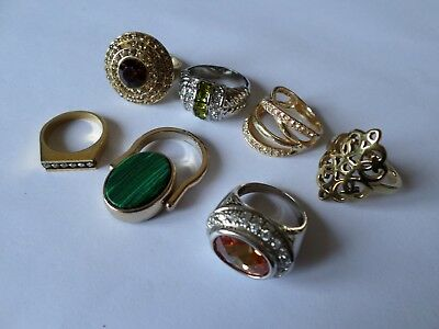 7  modern mostly gold tone finger rings