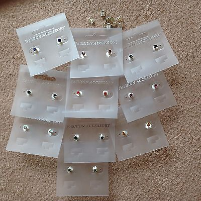 JOB LOT-10 pairs of 7 different colours 0.4cm crown set diamonte stud earrings