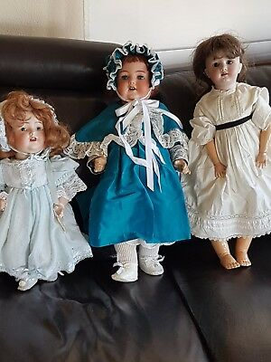 THREE ANTIQUE DOLLS (PRE-1930) in well kept condition.