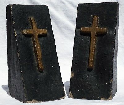 Folk Art Pair of concrete bookends painted black with raised crosses in gold.