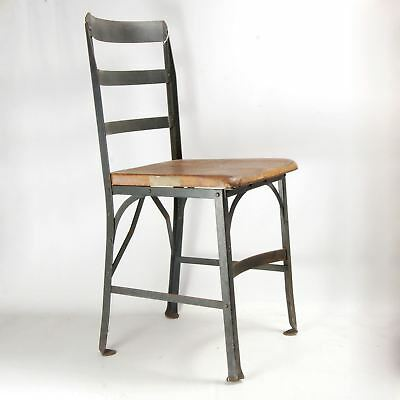 Olive drab enamel industrial chair marked  Angle Steel Stool Co Stamp Wood Seat