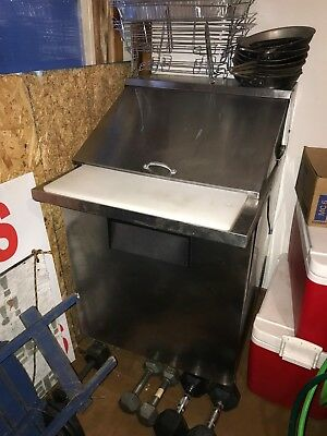 refrigerated sandwich prep table, used as is condition. Runs and gets cold.