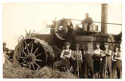 We Have Here a Real Photo Postcard of Large Steam Einginw  close Men standing