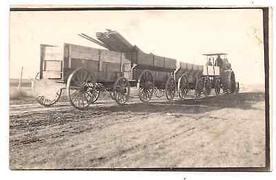 We Have a Real Photo Postcard of Large  Rumely Gas Tractor & Wagons