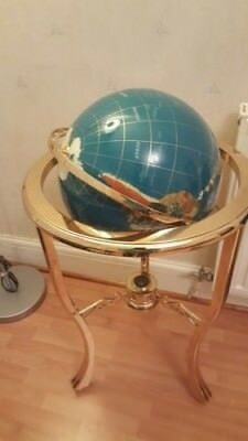 Turquise globe on metal stand( off balance)