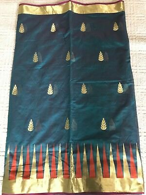 Beautiful deep green saree with zari embroidery, temple border & stitched blouse