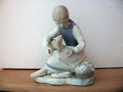 Lladro Style Figurine    GIRL MASSAGING FOOT  Made In Spain