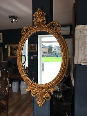 A Regency Gitwood Wall Mirror with Carved Mouldings