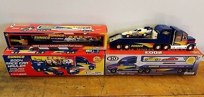 Sunoco toy trucks - four. displayed only.