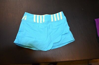 Girls Ivivva Tennis skirt, Size 6 blue with yellow striped band, great condition