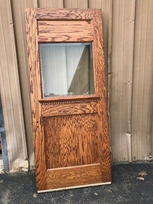 OXF 26 a antique tiger oak beveled glass entrance door 36 x 84.25