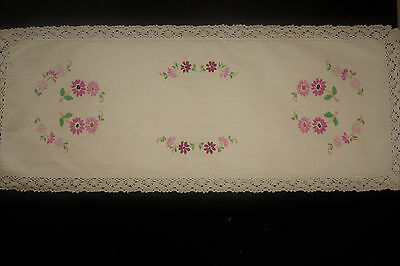 Vintage beige linen table runner with hand embroidered purple and mauve flowers.
