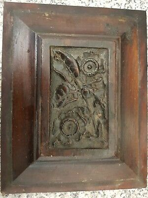carved walnut panel