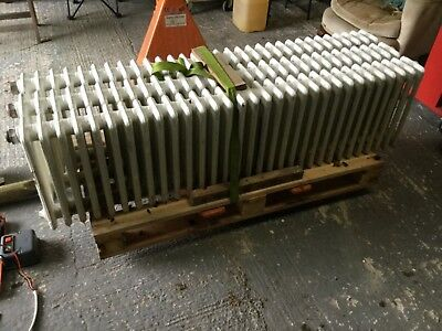 Cast iron radiators x 2   ( 3 in picture but 1 already sold..64 inches length.)