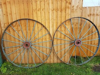 Pair of Architectural    Large cast iron cart wheels  with centre hub.