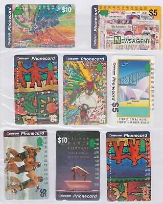 (K70-81) AU mix of 8 cards $5 & $10 used phone cards (CF)