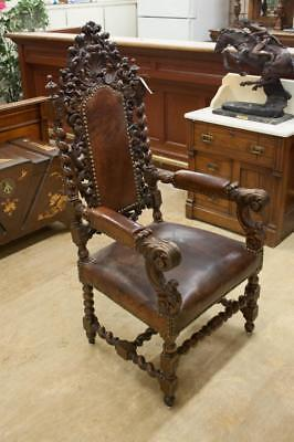 A HIGHLY CARVED CHARLES II STYLE ARMCHAIR, English Lot 433