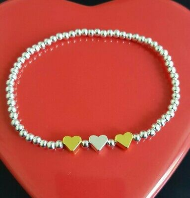 silver plated stretchy stacking bracelet with gold and silver plated heart charm