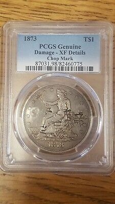 1873 T$1 PCGS Genuine with chop marks. Trade Dollar