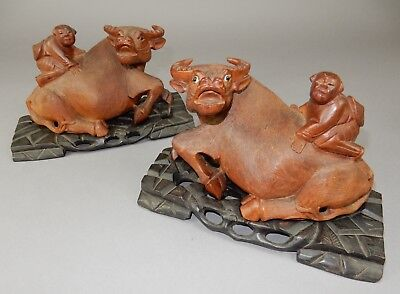 Pair of intricately Carved Chinese Water buffalo statues with boy , fitted base
