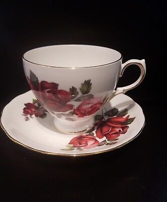 Queen anne tea cup and saucer gold ridges, deep red rose pattern made in England