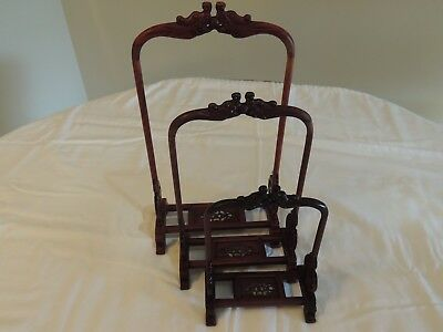 Chinese handcarved wood stands (set of three)