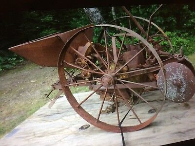 Antique single row horse drawn potato planter