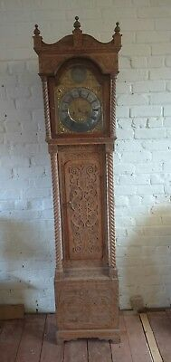 Extensively Carved Oak 8 Day Striking Longcase Clock