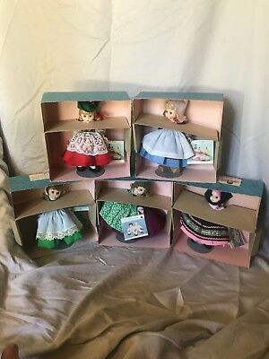 """Lot of 5 Madame Alexander Dolls Around the World 8"""" - With tags, boxes and stand"""