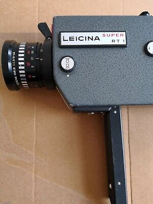 Leicina Super RT1 with Leicina Vario 8-64mm/1.9, W/ leather case.