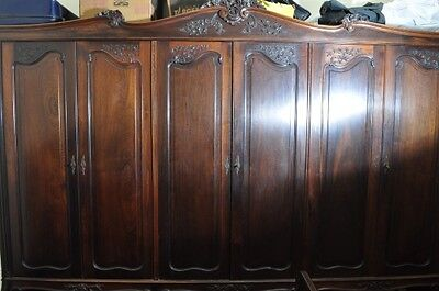 Astonishing Vintage Solid Brazilian Rosewood Armoire. Three meters wide!
