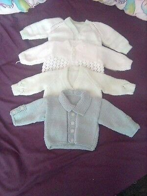 4 hand knitted baby boy cardigans