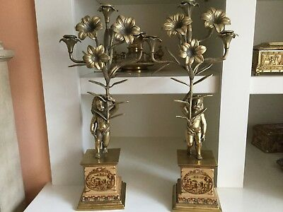 Pair of antique bronze candelabras  with cherubs, early 20 century