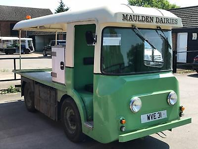 AN OPPORTUNITY TO BUY AN IDENTICAL PAIR OF 1960's HARBILT ELECTRIC MILK FLOATS