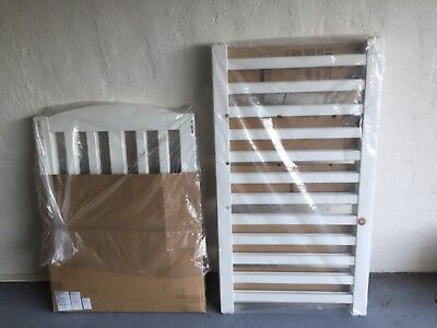 Baby cot with waterproof mattress