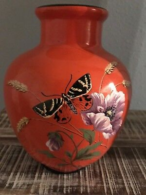 Vintage vase with butterfly and floral motif