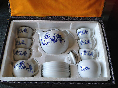 Boxed Chinese teapot and cups set, blue and white, fish design, used.
