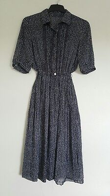 Vintage Dress. Fits: Size 8. Midnight Blue with printed white spots and lace.