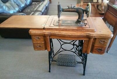 Antique New Home Treadle Sewing Machine In Tiger Oak Cabinet c.1910